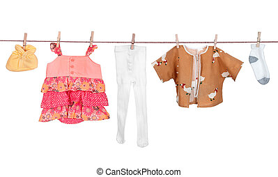 Baby clothes drying on a rope