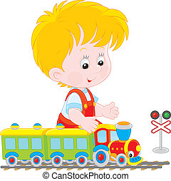 Child playing with a train - Little boy playing with a small...
