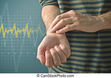 Man checking pulse with fingers - Man checking his pulse by...