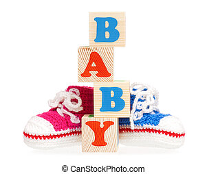 Cubes with booties - Baby word formed by wood alphabet...
