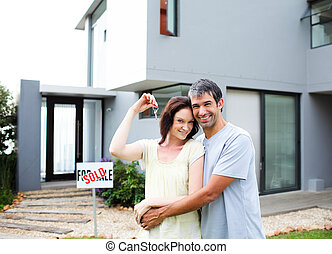 Happy couple after buying house - Happy young couple after...