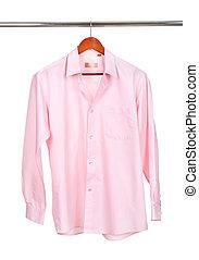 pink shirt on wooden hanger