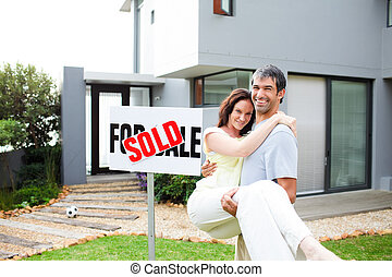 Newlyweds with their new house - Happy newlyweds with their...