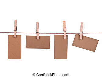 close up of a note and a clothes peg on white background...