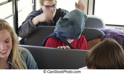 Bully on school bus - Kid being harassed picked on by...