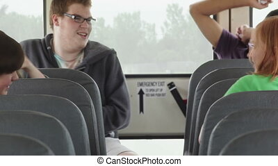 Kids playing & riding a bus - High school kids playing with...