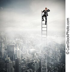 Look to the future - Businessman that looks far on a stair