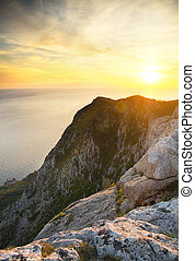 view on ocean - Sunset in hight mountains. view on ocean