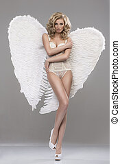 Photo of sexy blonde woman with long hair wearing angel's...