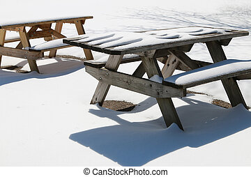 Snow Covered Picnic Tables