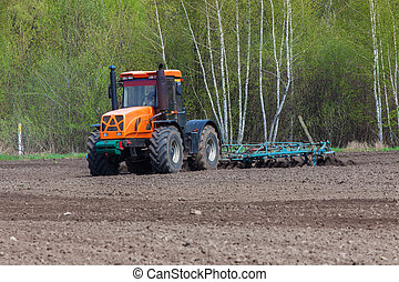 Tillage - Tractor plowing the field in the spring