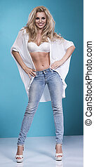 blonde beauty wearing sexy lingerie and jeans