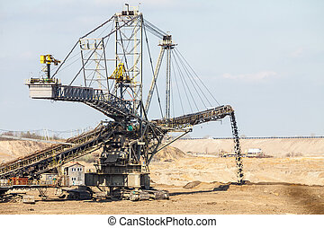 Opencast brown coal mine. Giant excavator. - Open pit....