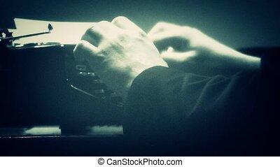 Close-up of man typing on typewriter - film noir style...