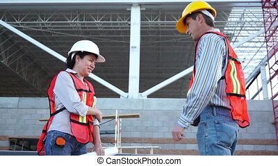 Industrial Workers Thumbs Up - Male and female construction...