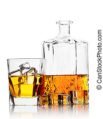Bottle and a glass of whiskey with ice isolated on white...