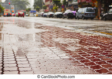 Heavy rain on the road in the city Kuala Lumpur - selective...