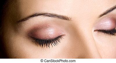 eye makeup closup of brunette and pretty skin