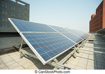 Rooftop solar power station - solar panel on the roof. Power...