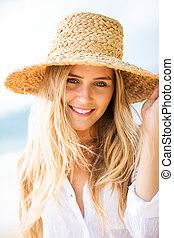 Smiling woman outdoors - Beautiful young smiling woman...