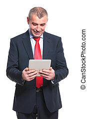 business man looks at his tablet