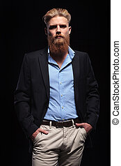 bearded business man with hands in pockets - portrait of a...