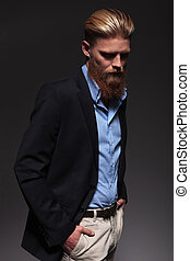 bearded business man looking down