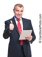 business man with tablet shows thumb up - mid aged business...