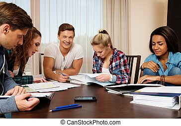 Multi ethnic group of students preparing for exams in home...
