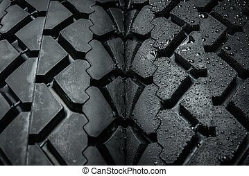 Close-up shot of classical motorcycle tire tread - Comparing...