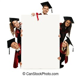Multi ethnic group of graduated young students with blank...