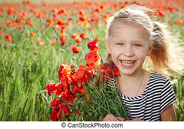 Happy laughing little girl on the poppy meadow - Happy...