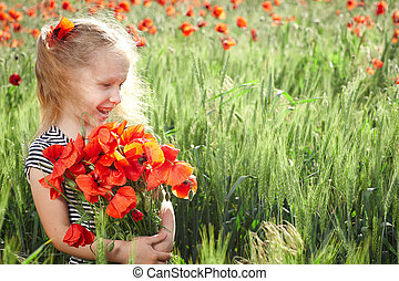 Little girl on the poppy meadow with posy - Happy smiling...