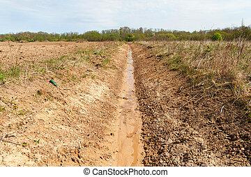 Fresh ditch. - New ditch in farmland.