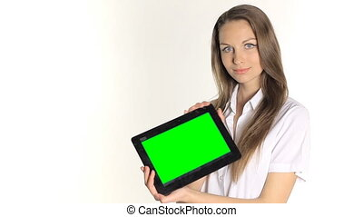 Beautiful girl shows information from the tablet on a white background
