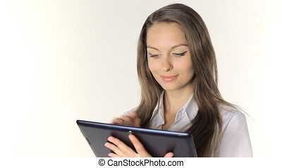 Beautiful girl shows information from the tablet on a white...