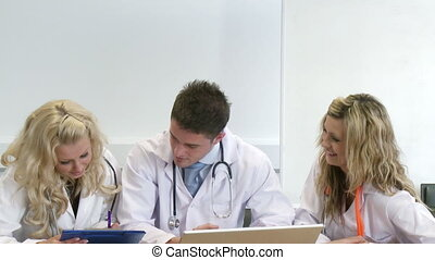 Three young doctors working together