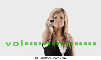 Woman turning down volume - Businesswoman turning down...