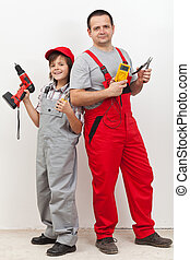 Boy helping his father with some electrical work - standing...