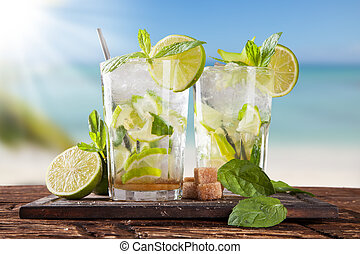 Summer mojito drinks on beach - Summer drinks with blur...