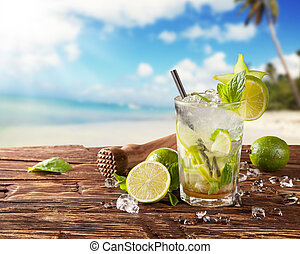 Summer mojito drink on beach - Summer drink with blur beach...