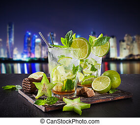 Summer mojito drinks at night city