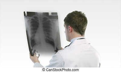 Doctor looking at an xray - Serious Doctor looking at an...