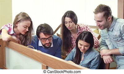 Group Discussion - Close up of group of students getting...
