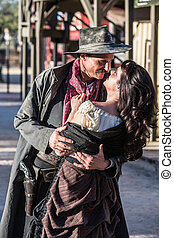 Gruff Man and Woman Kiss - Portrait of an old west woman and...
