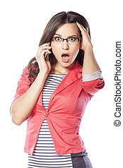 shocked young woman talking on the phone