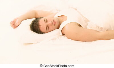 Young Handsome Man asleep on bed