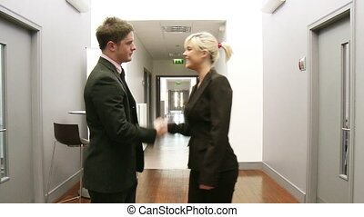 Business handshake in a corridor
