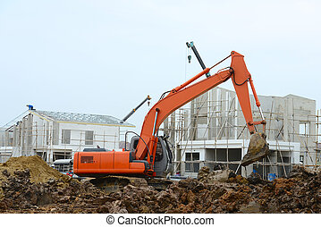 Excavator working in new housing building project