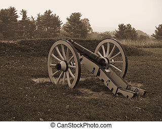 Revolutionary War Cannon - A sepia toned photo of a historic...